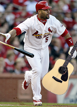 Pujols tosses his bat, retains his guitar